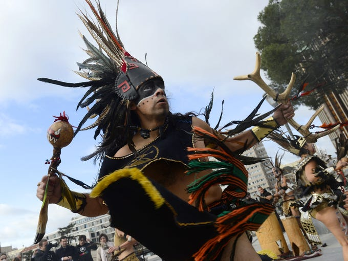Costumed dancers perform during a ceremony marking the end of the Maya cycle of Bak'tun 13 on Dec. 21 in Madrid, Spain. People who believe an ancient Maya calendar predicts the end of the world gathered to celebrate the event in various locations around the world.