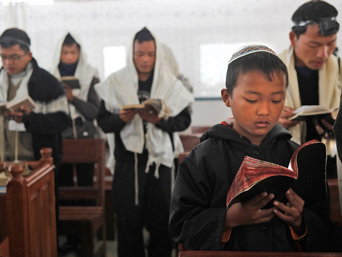 People belonging to the Bnei Menashe Jewish community pray in a synagogue before leaving for Israel on Dec. 20 in Churachandpur, India. The Jewish people claim to be descendants of one the 10 lost tribes of Israel who were banished to India in the 8th Century B.C.
