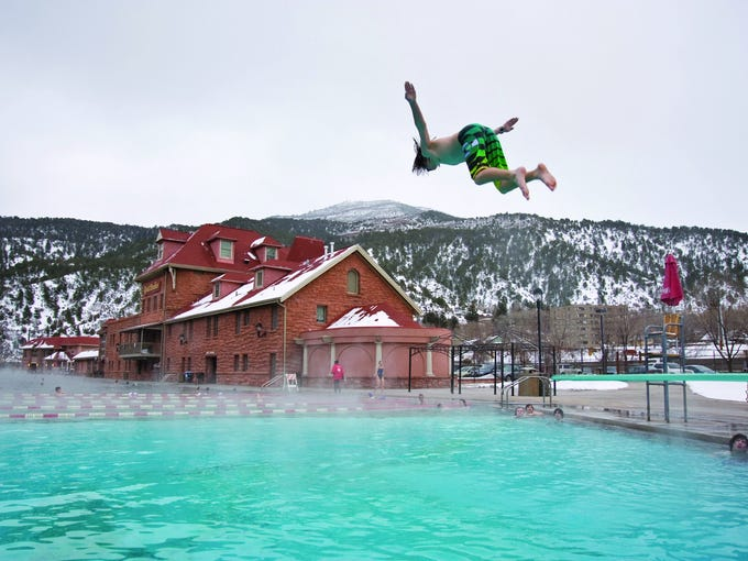 Each day, the Glenwood Hot Springs mammoth pool circulates with 3.5 million gallons of naturally heated spring water.  Glenwood opened in 1888 as the world's largest hot springs pool.