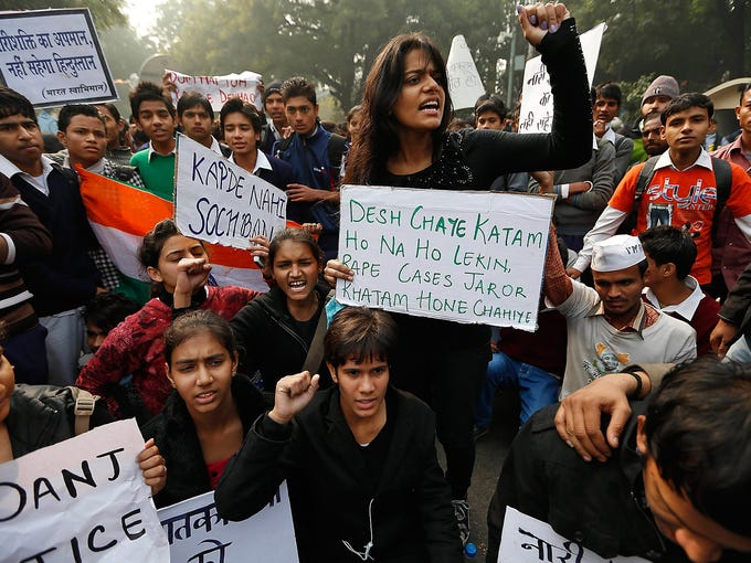 "Students shout slogans during a protest against a vicious gang rape on Dec. 24 in New Delhi. Police closed roads in an attempt to end a week of demonstrations against the brutal gang rape of a student on Dec. 16. The signs read, ""Change attitude toward women and not the way they dress,"" ""India will not withstand insult to women"" and  ""Whether the country ends or not all rape cases should come to an end."""