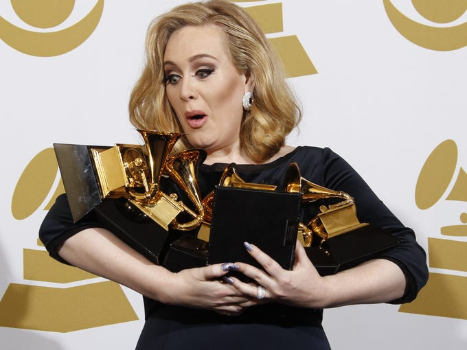 Adele was the big winner at the 2012 Grammys. So much so that she could not hang onto all six of her trophies in the press photo room. Adele won awards for best pop solo performance for 'Someone Like You,' song of the year, record of the year and best short form music video for 'Rolling in the Deep,' and album of the year and best pop vocal album for '21.' She also welcomed a baby boy in October with Simon Konecki.