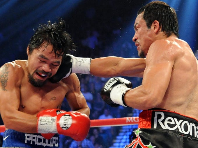 <b>THE YEAR IN BOXING:</b> On Dec. 8, a good year in boxing suddenly became great. That's when the punch heard 'round the world from a bloodied and battered Juan Manuel Marquez dropped Filipino superstar Manny Pacquiao with one  second left in the sixth round. The 'perfect punch' sent shock waves through boxing. A dying sport? Not judging by the way this non-title bout blew up on the sports pages and in social media. Pacquiao's fall put an exclamation point on the year in boxing. USA TODAY Sports' Bob Velin takes you through the best and worst of boxing in 2012: