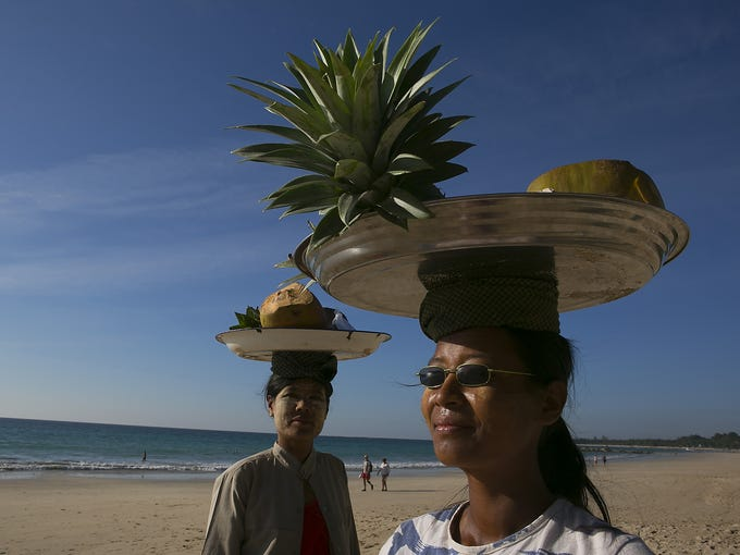 Women sell fruit on Nov. 29 on Ngapali Beach in Burma. Burma possesses great tourist potential, and the country's tourism industry is developing fast.