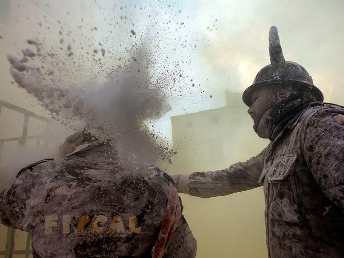 People battle with food during the festival of Els Enfarinats on Dec. 28 in Ibi, Spain. For 200 years the citizens of Ibi have staged a battle using flour, eggs and firecrackers outside city hall.