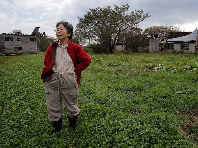 Farmer Keiko Kikukawa stands in her field on Nov. 7 in Rokkasho village, Aomori Prefecture, Japan. The village is the home of a high-tech facility being built to convert spent nuclear fuel to feed Japan's next generation of reactors.