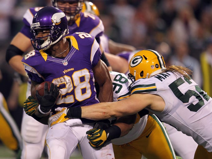 Minnesota Vikings running back Adrian Peterson (28) carries the ball during the first quarter against the Green Bay Packers at the Metrodome.