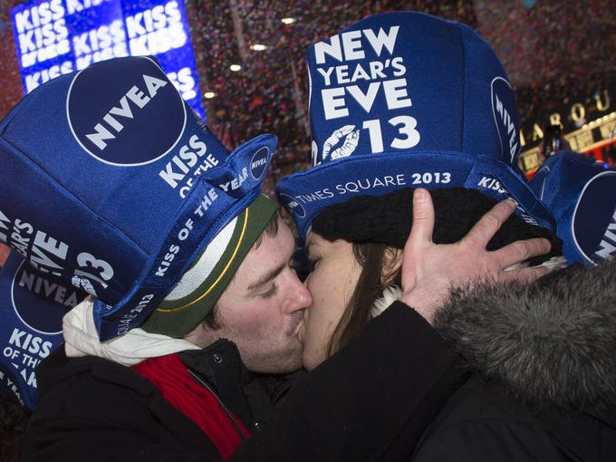 Jeremy Turnmeyer, 23, and Emily Mae Billington, 21, of Wisconsin, share a kiss in Times Square at midnight on New Years.