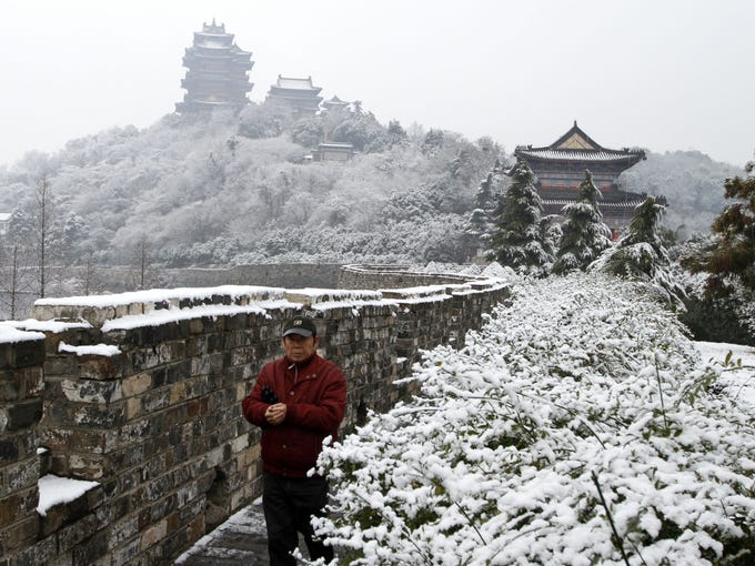 China is experiencing unusual chills this winter with its national average temperature hitting the lowest in 28 years. The scene in Nanjing in eastern China's Jiangsu province after a snowfall on Dec. 26, 2012.