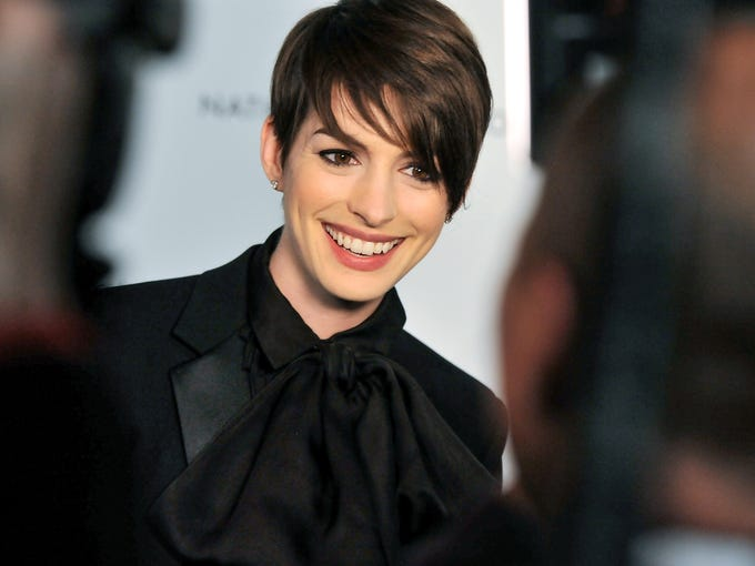 'Les Miserables' star Anne Hathaway is all smiles while chatting with the press at the National Board of Review Awards gala in New York on Jan. 8. The film received the award for best ensemble.