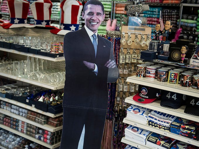 A cardboard cutout of President Obama is displayed in front of shirts and other items imprinted with his image at the Souvenir World shop on Jan. 8 in Washington, D.C.