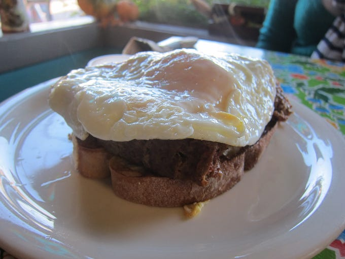 The specialty open-faced breakfast sandwiches at Auntie Em's are delicious, and the beef-meatloaf version is the most popular.