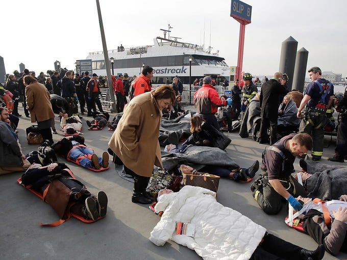 Rescue personnel help injured passengers from the Seastreak Wall Street ferry after the vessel hit a pier on Jan. 9 in New York City. The ferry from Atlantic Highlands, N.J., struck a pier as it arrived at South Street in Lower Manhattan during morning rush hour.