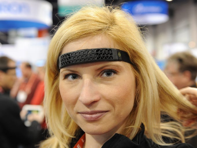 Eva Zeisel models a Spree headband, which monitors your motion, heart rate and body temperature to keep track of your physical performance and fitness health.