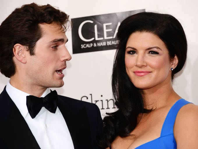 "Gina Carano, right, made her name in MMA but now is a movie star, and her dating proves it. Here, she attends the Critics' Choice Movie Awards in Santa Monica, Calif., Thursday with boyfriend and ""Man of Steel"" actor Henry Cavill. Flip through this gallery for more photos of Carano through the years."