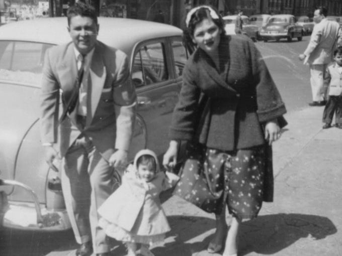 """Photos from Sonia Sotomayor's new book, """"My Beloved World."""" Sonia, age 1, between her mother and father, Juan and Celina (Baez) Sotomayor."""