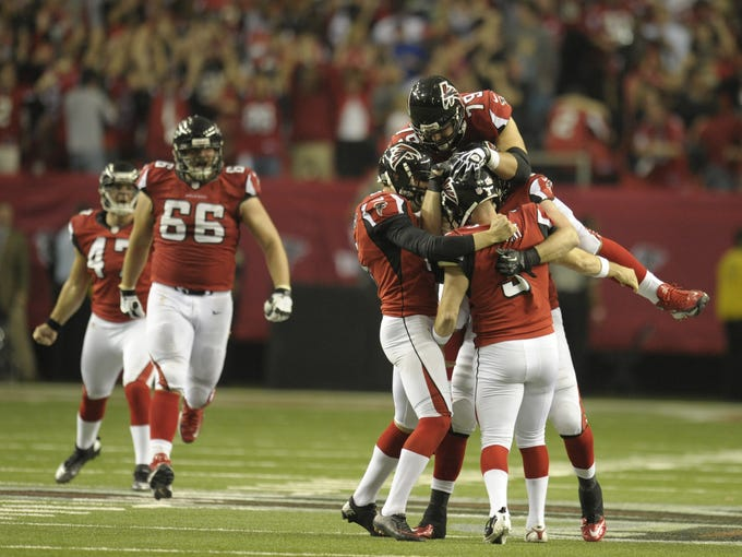 Atlanta Falcons kicker Matt Bryant (3) celebrates with teammates after kicking the game-winning field goal against the Seattle Seahawks during the fourth quarter of the NFC divisional playoff game at the Georgia Dome. The Falcons won 30-28.