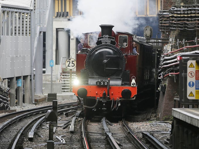 Metropolitan 1, a restored steam train built in 1898, passes through Farringdon Tube station on its journey between Olympia Tube station in the west to Moorgate station in London on Jan. 13, as part of the celebrations for the 150th anniversary of the London Underground Tube system. The first stretch of the world-famous network opened to the public Jan. 10, 1863.
