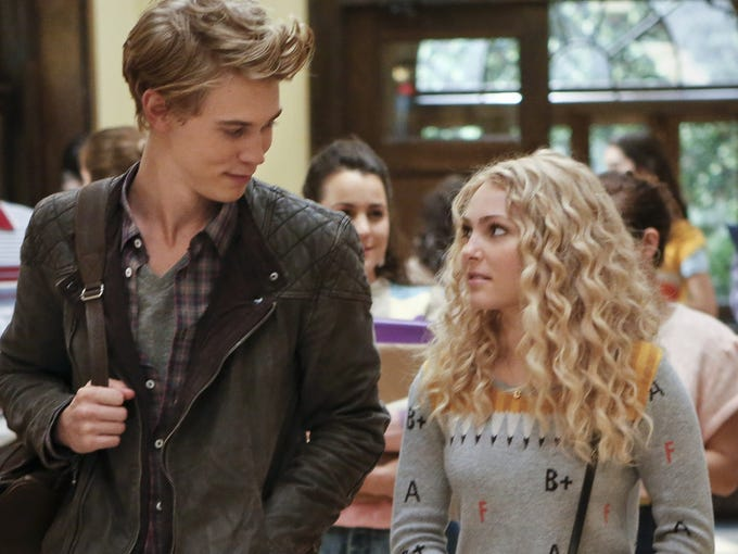 """The """"C"""" is for """"chic."""" Carrie Bradshaw (AnnaSophia Robb) wears an initial necklace by jewelry designer Alex Woo and a sweater and jeans from Urban Outfitters. She is joined by Sebastian (Austin Butler)."""