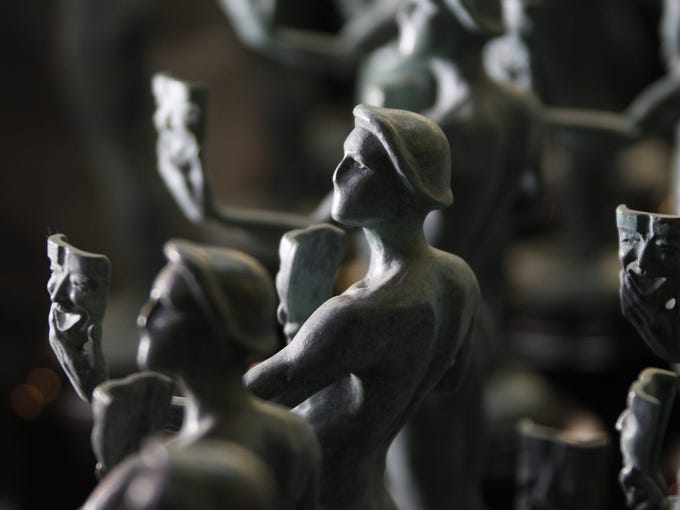 A row of finished statuettes, a form known as The Actor, await transportation to the Screen Actors Guild (SAG) Awards, to be held Jan. 27, 2013, at the Shrine Auditorium in Los Angeles. The bronze statue is 16 inches high and weighs 12 pounds.  • The Actor was sculpted by Edward Saenz and designed by Jim Heimann and Jim Barrett. • Burbank's American Fine Arts Foundry has been creating the individually numbered statuettes since the SAG Awards'' inception in 1995.  •