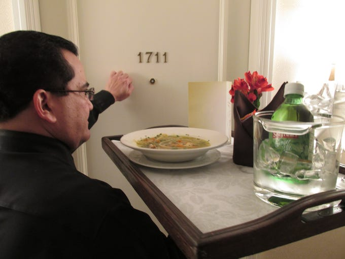 Guests at all of the USA's Omni hotels can expect a complimentary bowl of chicken soup delivered to their room if they're sick. Here, employee Jose Rodriguez delivers chicken soup to a guest at the Omni Mandalay Hotel in Las Colinas, Texas.