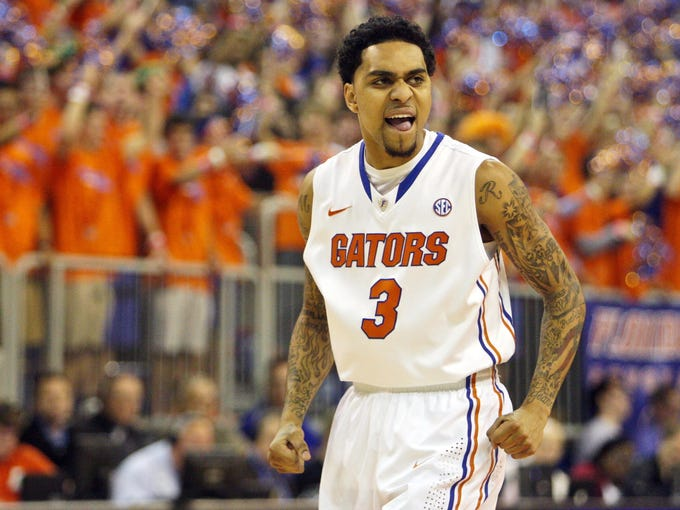 Florida Gators guard Mike Rosario (3) reacts after a play during the first half of the game against the Missouri Tigers at the Stephen C. O'Connell Center. Florida won 83-52.
