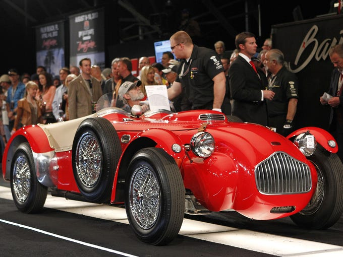 A 1952 Allard J2X race car rolls across the block at the Barrett Jackson auction Jan. 19 in Scottsdale, Ariz. The car is powered by a 365-cubic-inch Cadillac V-8 engine.
