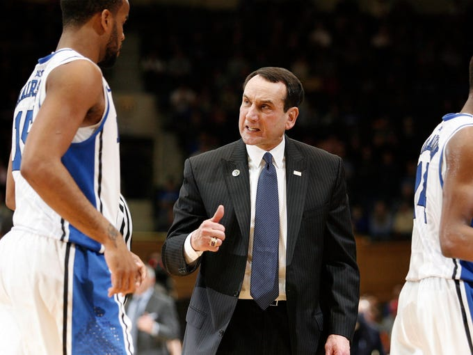 Duke coach Mike Krzyzewski talks to forward Josh Hairston (15) during a timeout against Georgia Tech during the second half at Cameron Indoor Stadium on Jan. 17. Duke went on to win 73-57.