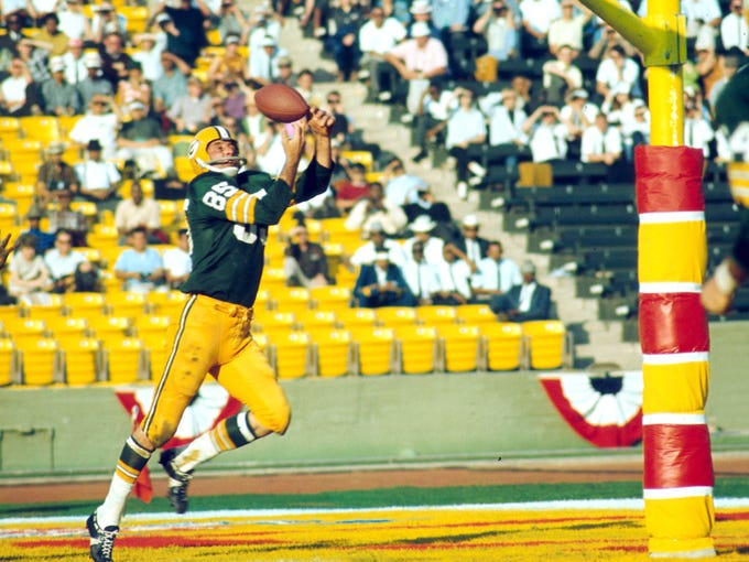 I: In the first Super Bowl at the Los Angeles Coliseum, the Packers asserted the NFL's supremacy over the AFL by trouncing the Chiefs 35-10. As part of the historic game, Green Bay's Max McGee had seven catches for 138 yards and two touchdowns, including this juggling act. Football would never be the same.