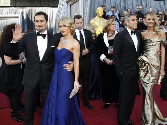 Demian Bichir, Stefanie Sherk, George Clooney and Stacy Keibler at the 84th annual Academy Awards. There was little reserved about last year's Oscar red carpet as stars stepped out of the basic black sartorial box and into gowns that glowed white and popped bright.