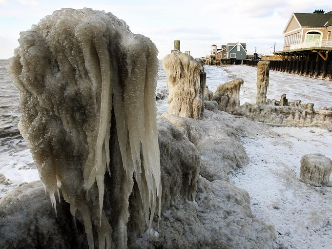 Ice coats the shoreline along the Delaware Bay in Middle Township, N.J., on Wednesday.