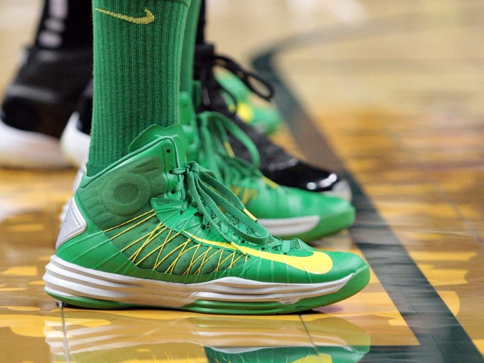 Oregon players wore Nike green and yellow shoes with green socks during the game against Washington State.