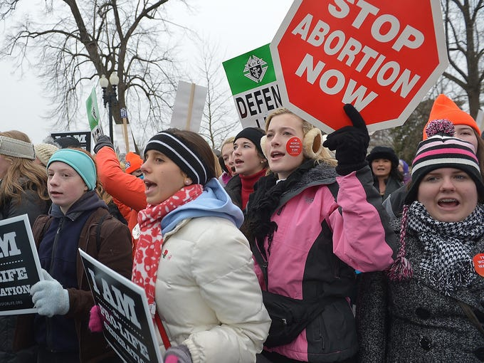 Anti-abortion activists yell slogans during the March for Life rally on Jan. 25 in Washington, D.C. Demonstrators are staging a protest on the anniversary of the Supreme Court's Roe v. Wade decision in 1973, which legalized abortion.