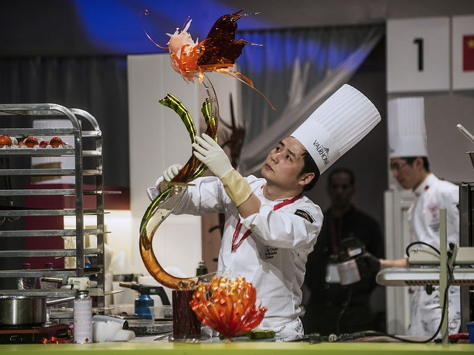 Chinese chef Chao Zhang finishes his entry during the World Pastry Cup competition at the International Restaurant, Hotel and Food Industry Show on Jan. 28 in Lyon, France.
