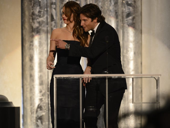 Oops! Bradley Cooper points to the side of the stage where he and 'Silver Linings Playbook' co-star Jennifer Lawrence are supposed to be standing in order to introduce a clip from the film at the Screen Actors Guild Awards at the Shrine Auditorium in Los Angeles on Jan. 27. Lawrence won the award for lead actress.