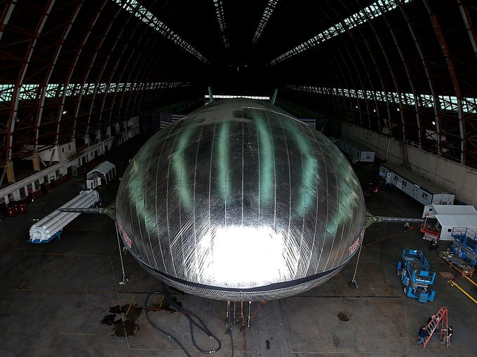 The Aeroscraft, a high-tech prototype airship, rests in a World War II-era hangar on Jan. 24 in Tustin, Calif. Work is almost complete on the 230-foot airship, a prototype for future craft that will slash costs for moving heavy cargo around the world.