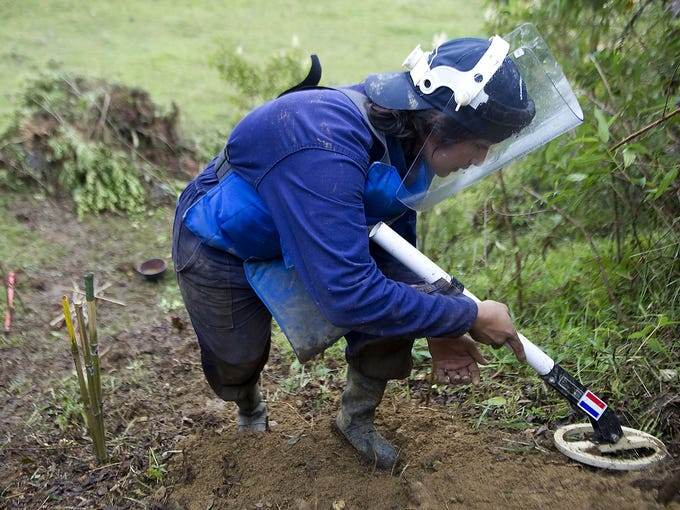 A student searches for land mines during a training exercise on Jan. 23 in El Retiro, Colombia. Fourteen civilians have been trained by The  HALO Trust, England's oldest and largest land-mine-clearing organization, to find and remove land mines from areas of conflict in Colombia.