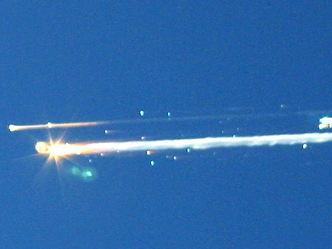 The space shuttle Columbia breaks up during re-entry into Earth's atmosphere on Jan. 1, 2003, over Tyler, Texas. All seven astronauts were killed as they were gliding toward a landing in Florida.