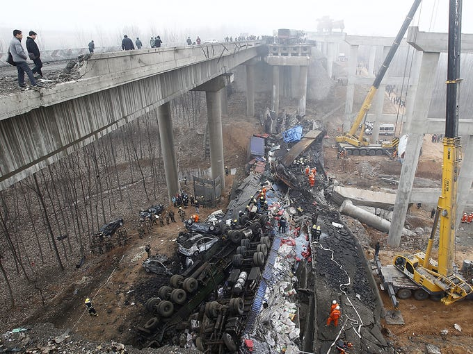 Rescuers search for survivors after a truck loaded with fireworks exploded and destroyed a section of elevated highway on Feb. 1 near Sanmenxia, China. Twenty-six people were killed when a truck packed with fireworks exploded, causing 260 feet of roadway to collapse.