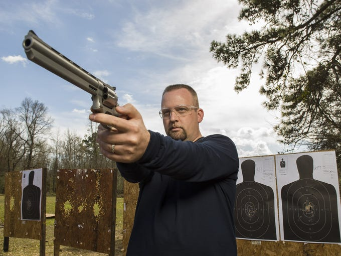 """Pastor James McAbee, known around town as the """"Pistol-Packing Preacher,"""" keeps his black, loaded Glock in a holster tucked in his pants at all times, whether making a deposit at the bank or preaching from the pulpit of the Lighthouse Worship Center, an Assembly of God church where he pastors."""