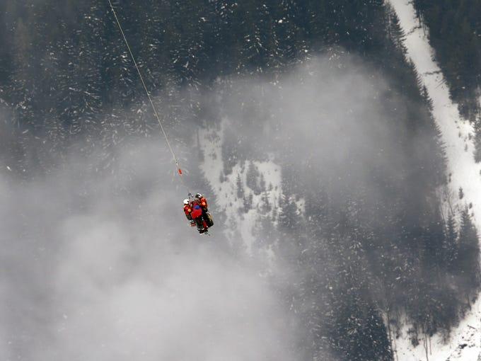 †Lindsey† Vonn is airlifted by an helicopter after crashing during the women's super-G course, at the Alpine skiing world championships in Schladming, Austria.