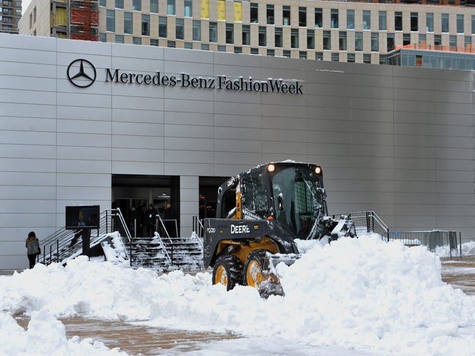 The shows must go on, so crews were out early Saturday morning to clear snow from the plaza in front of the tents at Lincoln Center.