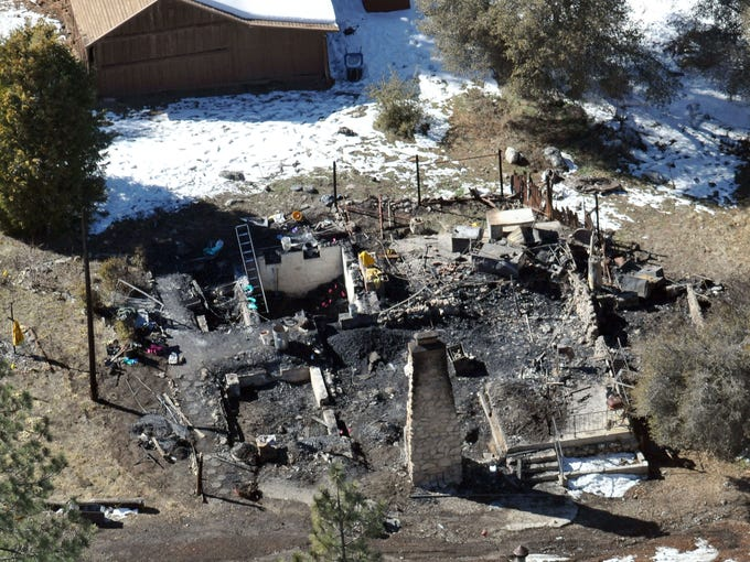 This aerial photo shows the cabin that burned on a California mountain Tuesday as the hunt for fugitive Christopher Dorner drew to a close.