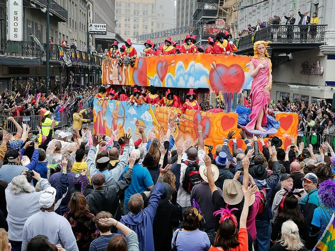 A float in the Krewe of Zulu parade maneuvers through the crowd during Mardi Gras celebrations on Canal Street on Feb. 12 in New Orleans. Fat Tuesday revelry gives way to the solemnity of Lent that begins with Ash Wednesday.