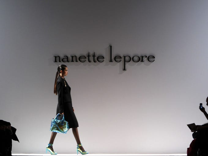 Oceanic blues, volcanic reds and militaristic greens colored the Nanette Lepore Fall 2013 collection.