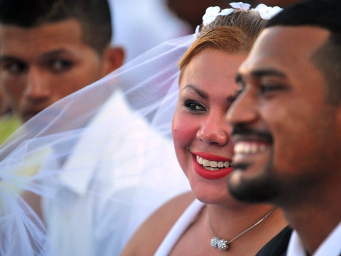 A couple takes part in a mass Valentine's Day civil wedding of 560 couples held in Managua, Philippines.
