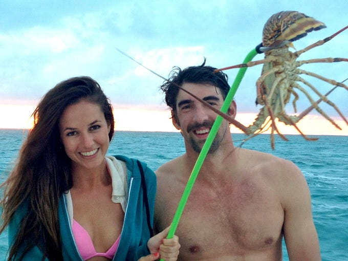 Sarah Herndon and Michael Phelps lobster fishing in the Bahamas.