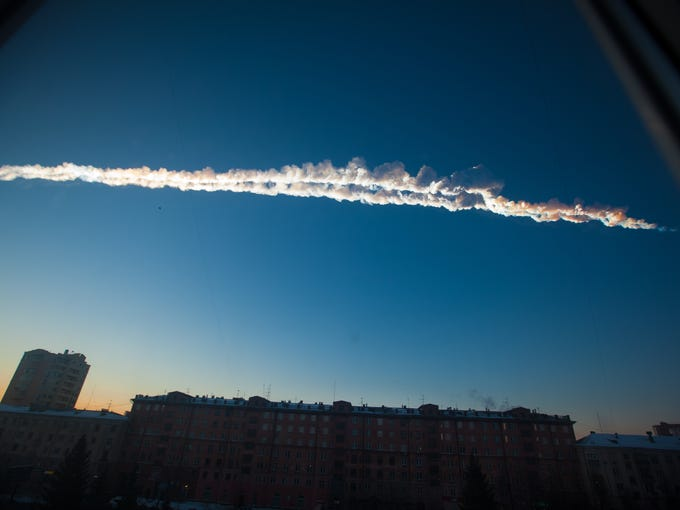 In this photo provided by Chelyabinsk.ru, a meteorite contrail is seen over Chelyabinsk on Feb. 15.