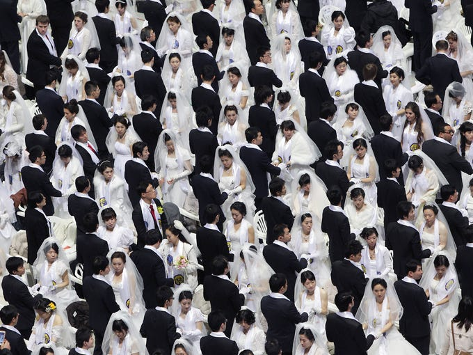 Thousands of Unification Church couples take part in a mass wedding ceremony at Cheongshim Peace World Center on Feb. 17 in Gapyeong-gun, South Korea. About 3,500 couples from 200 countries exchanged wedding vows. It was the first mass wedding since Unification Church founder Sun Myung Moon died in September.