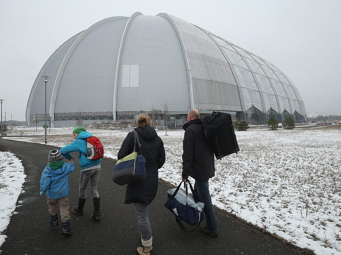 Visitors arrive at a giant hangar housing the Tropical Islands indoor resort on Feb. 15 in Krausnick, Germany. Located on a former Soviet-era military air base, the resort is built inside a hangar once used for airships.