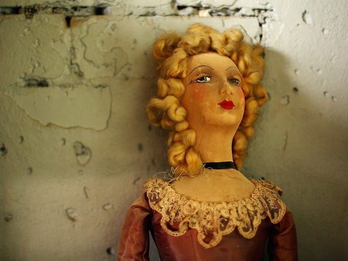 An old doll is propped against a wall at Sydney's Famous Original Doll Hospital on Feb. 19 in Bexley, Australia. Established in 1913 by Harold Chapman Jr., the hospital will celebrate 100 years of repairing antique dolls.